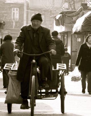 Old Man on Cart